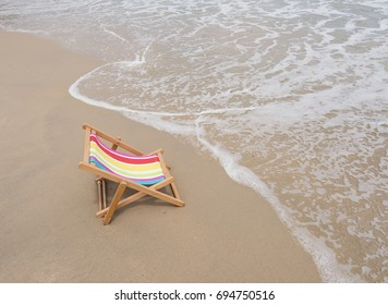 Deck chair at the tropical beach