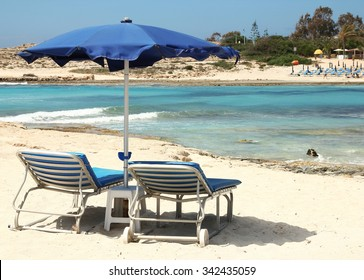 a deck chairs on the beach