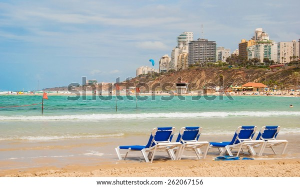 Deck chairs on shore near sea on the beach in Israel