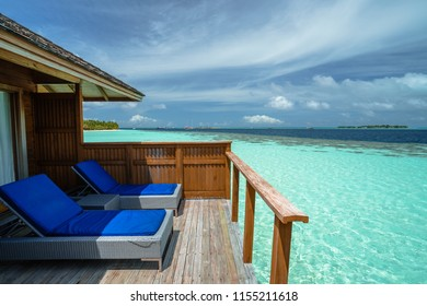 Deck chairs and sea view, resort in Maldives