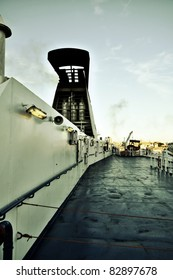 The deck of a ferryboat leaving the port of Genova in the evening light
