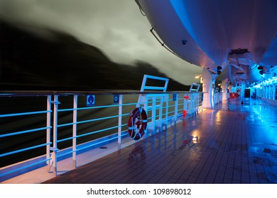 Deck with lifeboats in evening light