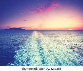 Deck on Ferry sailing across the mediterranean sea during beautiful sunset