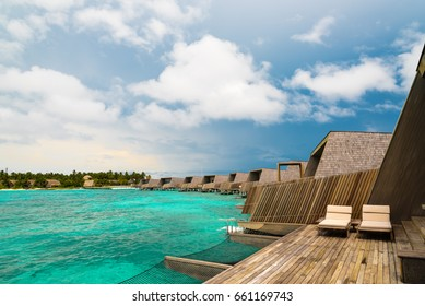 deck of an over water villa on the maldives