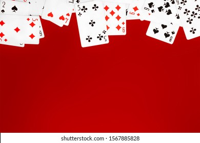 Deck of playing cards on red background table copy space