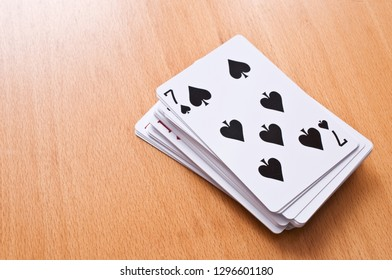 Deck of playing cards on the table.