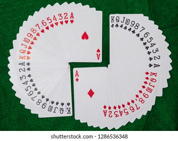 Deck of playing cards,  thirteen ranks in each of the four suits, clubs, diamonds, hearts and spades.