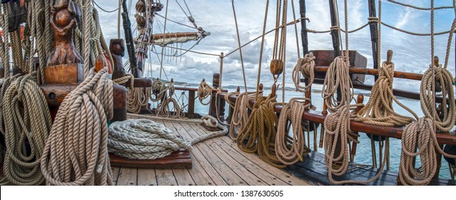 deck of a sailboat full of ropes or wooden sailboat