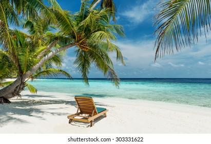 deckchair on a beautiful untouched tropical beach