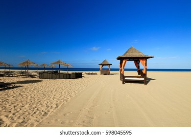 DECKCHAIR AND UMBRELLA ON THE BEACH OF SANTA MARIA , SAL ISLAND ,CAPE VERDE