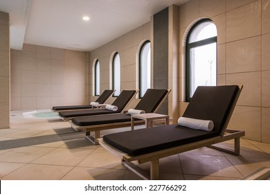 deckchairs and jacuzzi in health spa