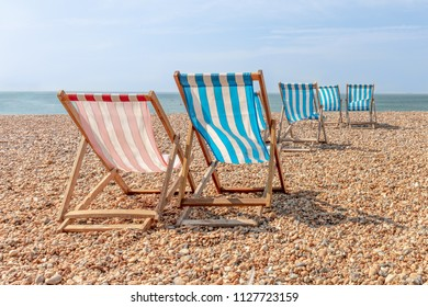 Deckchairs on a Shingle Beach in Summer