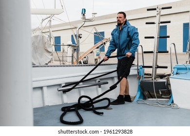 Deckhand worker man working inside boat at ship port - Focus on face