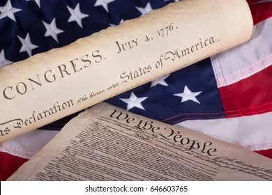 Declaration of independence and United States constitution on an american flag