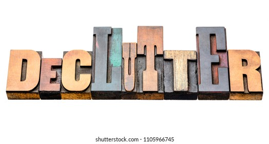 declutter - isolated word abstract in vintage letterpress wood type blocks, mixed fonts