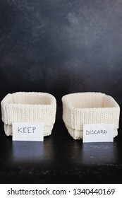 decluttering and tidying up concept: storage baskets to divide items to keep from those to declutter or donate