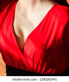 Decollete of young woman with beautiful breast cleavage