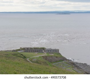 Decommissioned Brean Down Fort at the End of the Limestone Promontory on the Bristol Channel, with Wales in the Background, and part of the Mendip Hills on the Coast of Somerset, England, UK