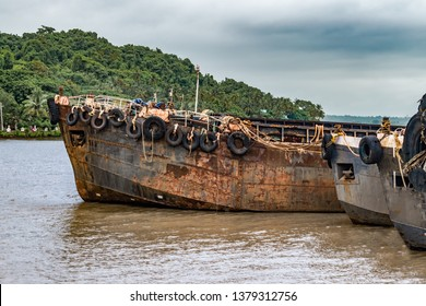 Decommissioned Feeder Vessels generally known as Barges, beached up at Ship Breaking Yard. Once used for transporting bulks to mother vessels, are now obsolete due to global recession and mining ban.