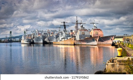 "Decommissioned Navy ships, sometimes called the ""mothball fleet"", at an east coast port."