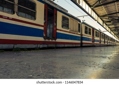 Decommissioned trains in an abandoned train station.