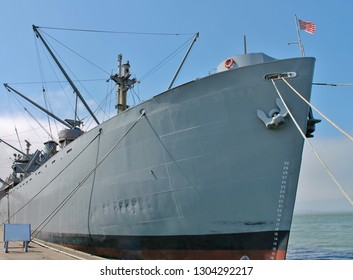 A decommissioned U.S. Naval warship anchored in the harbor of San Francisco
