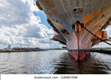A decommissioned US Navy aircraft carrier sits in an east coast port awaiting its final voyage.