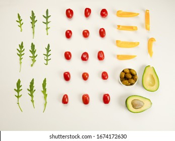 decomposed ingredient for salad on white background. Concept healthy vegetables, vegan, delivery food, vegetertian and organic. Food Knolling, flat lay, top view