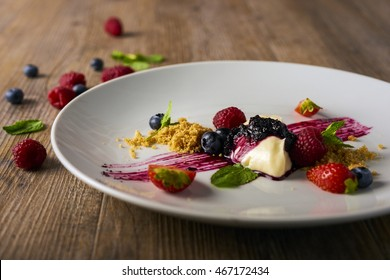 deconstructed cheesecake with mixed berries, selective focus