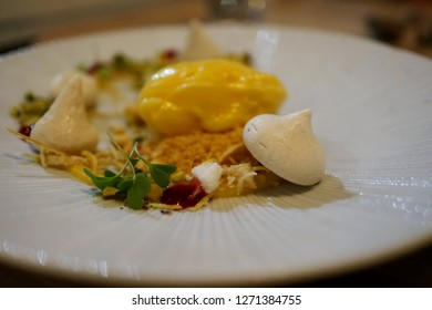 Deconstructed Citrus Meringue Tart with Raspberry Coulis, Crumble and Candied Zest