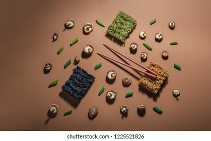 Deconstructed ramen illustrated by the ingredients used to create it. Photographed with direct light.