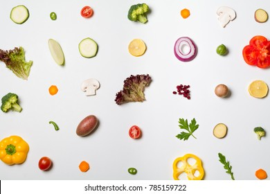Deconstructed salad ingredients on white background