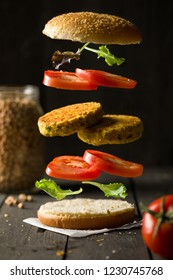 Deconstructured Vegan Hamburger with Chickpea Burger, Lettuce and Tomato