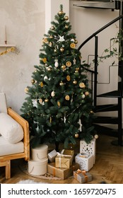 The decor of Christmas and New year. Christmas tree with toys and gifts
