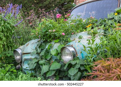 Decor of flowers in vintage car in the summer garden