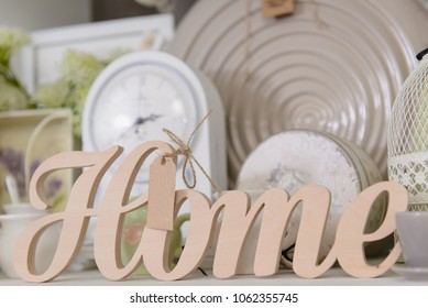 Decor for home in pastel colors in the shop. Wooden sign Home, Close-up.