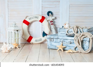 Decor in the style of sea travel, Suitcases and anchor, lifebuoy, lantern.