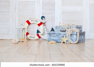Decor in the style of sea travel, Suitcases and anchor, lifebuoy, lantern