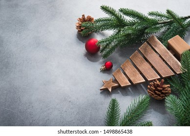 Decor wooden fir tree with branches on a stone background. Concept of Merry Christmas holiday.