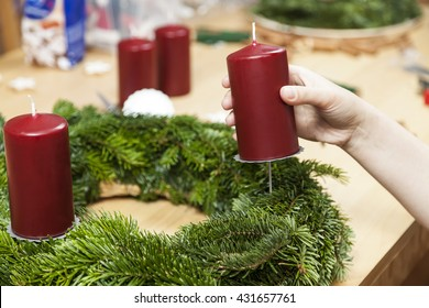 Decorate an advent wreath with candle