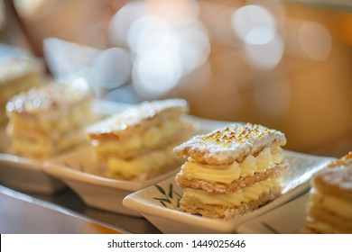 Decorate catering banquet table services background with different food snacks and appetizers, fresh fruits on bartender counter in hotel restaurant. Snack foods serving in corporate party event.