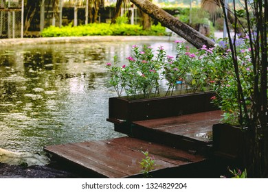 Decorate the garden with woods that make a bridge across the pond. And the thick stone sheet laid as a path.