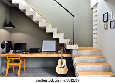 Decorate the loft-style staircase with a desk placed below.
