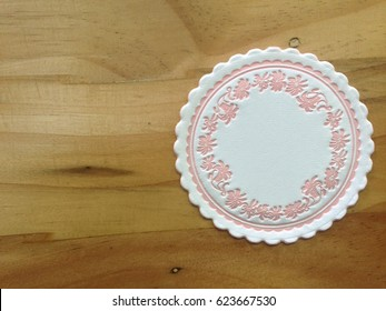 decorate paper coaster on wooden background