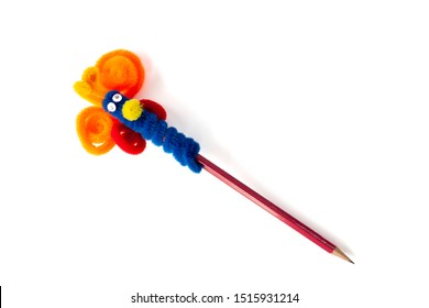 Decorate the pencil with a colorful pipe cleaner on pencil toppers for children interesting and fun isolated on white background.