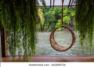 A decorate swing on the floating hotel among the forest at River Kwei , Kanchanaburi Thailand