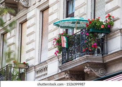 decorate terrace with umbrella and flower on second floor of building.
