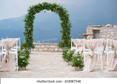 decorated arch and chairs at the wedding venue