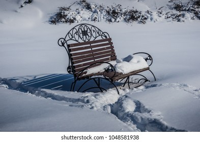 Decorated bench in snow
