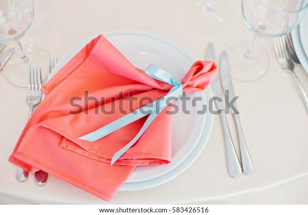 Decorated with blue ribbon with newlyweds names red napkin